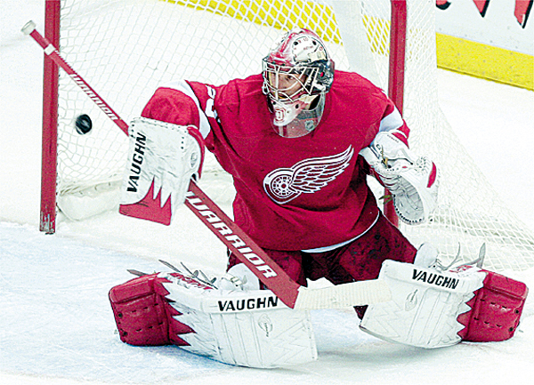Detroit Red Wings goalie Jimmy Howard blocks a Phoenix Coyotes shot in the third period of an NHL hockey game in Detroit, Monday, Dec. 14, 2009. Detroit won 3-2. (AP Photo/Paul Sancya)
