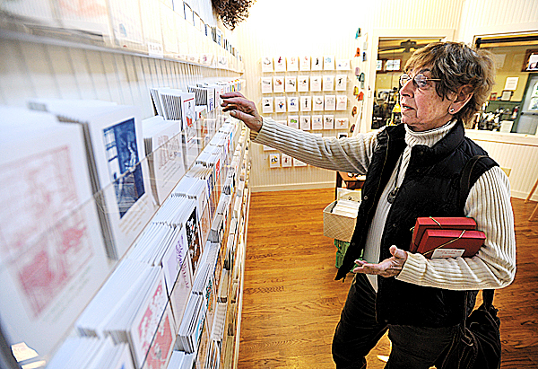 Swans Island resident, Joan Harding shops for Christmas cards at Saturn Press on Swans Island on Tuesday, December 8, 2009. Saturn Press uses ephemral images to create greeting cards on recycled paper. BANGOR DAILY NEWS PHOTO BY KEVIN BENNETT