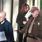 Matthew Sylvester at his court appearance, December 18, 2009 escorted by Waldo County Corrections Officer Dave Lindahl.  BANGOR DAILY NEWS PHOTO BY WALTER GRIFFIN