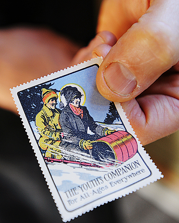 James vanPernis holds a stamp on Tuesday, December 8, 2009 from the early twentieth centuy that was use as the basis for a greeting card printed at Saturn Press on Swans Island. Saturn Press uses recylced paper and does not have a web site.BANGOR DAILY NEWS PHOTO BY KEVIN BENNETT