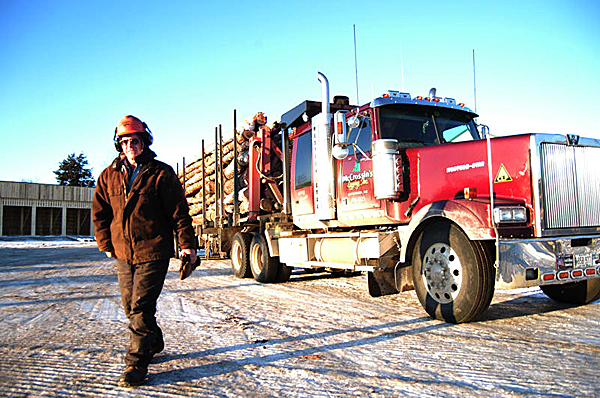 Logging trucker Steve McCrossin, 54, of Greenbush, finishes a shift at Treeline Inc. of Lincoln on Friday. He was pleased with a new federal law allowing trucks weighing 100,000 pounds to travel on interstates north of Augusta. ?It gets the trucks off the back roads,? he said. ?It?s a lot safer for everybody.?  BANGOR DAILY NEWS PHOTO BY NICK SAMBIDES JR.