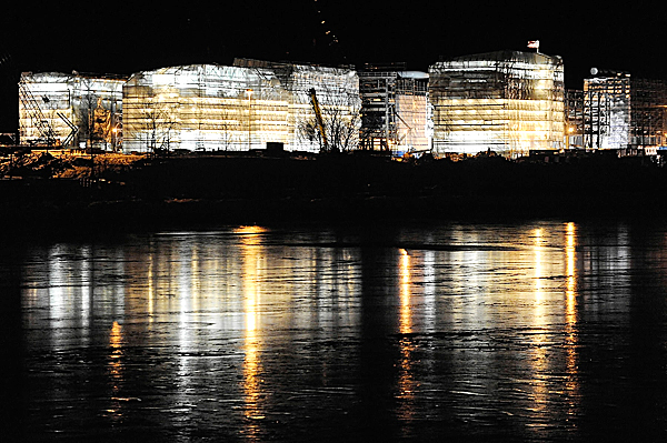 A nighttime view from Bangor,  looking across the Penobscot River to Cianbro's module construction facility in Brewer. Photographed Thursday evening, December 17, 2009. BANGOR DAILY NEWS PHOTO BY JOHN CLARKE RUSS