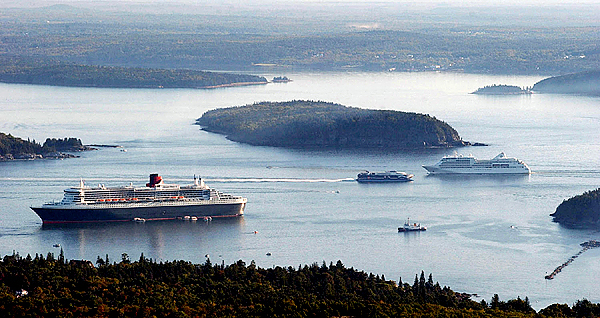 The 1,132-foot Queen Mary 2 sits at anchor near Bar Harbor while the 320-foot ferry the Cat approaches the 610-foot cruise ship Silver Whisper (right). (BANGOR DAILY NEWS PHOTO BY KEVIN BENNETT)