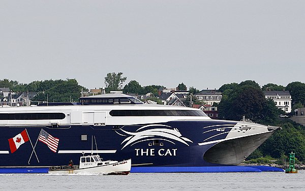 The high-speed Cat ferry dwarfs a lobster boat as it leaves Portland Harbor, bound for Yarmouth, Nova Scotia, Canada, on its first run of the season, Friday, June 5, 2009, in Portland, Maine.  (AP Photo/Robert F. Bukaty)