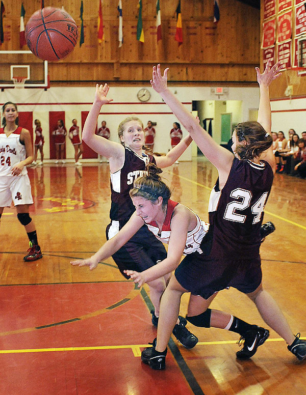 Central's Max McHugh, (10), gets sandwiched between GSA's Stevie Theoharides, (44), and Sarah Brown , (24), in the first half of their game in E. Corinth, Friday, Dec. 18, 2009. Bangor Daily NEws/Michael C. York