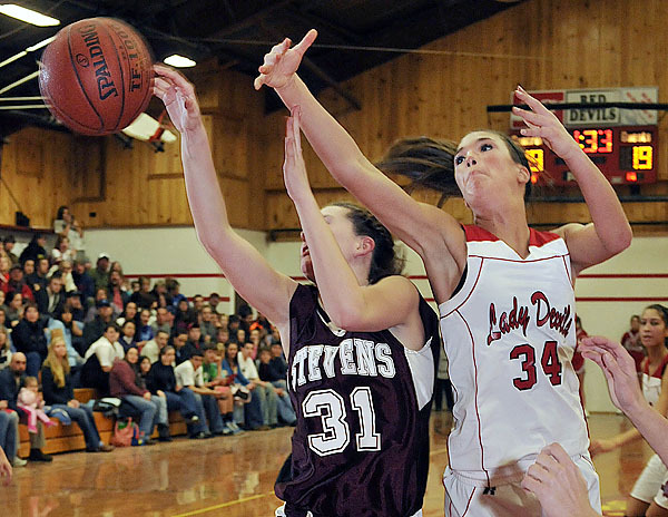 Centrals' Jocelyn Portmann, (34), swipes for a rebound with GSA's Lexie Brann, (31), in the first period of their game in E. Corinth, Friday, Dec. 18, 2009. Bangor Daily NEws/Michael C. York