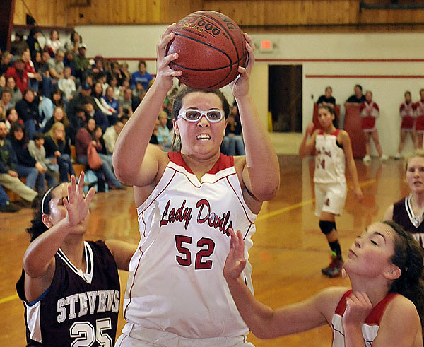 Central's Bekah Campbell, (52), grabs a loose ball over teamate Katie Day, (14), and GSA's India Frazier, (25), in the second half of their game in E. Corinth, Friday, Dec. 18, 2009. Bangor Daily NEws/Michael C. York
