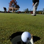 CAPTION  Husson University senior Ben Estabrook of Bangor gets in some putting practice near the club house before Monday morning's round of the North Atlantic Conference Golf Championship at Penobscot Valley Country Club in Orono. (Bangor Daily News/John Clarke Russ)   (WEB EDITION PHOTO)