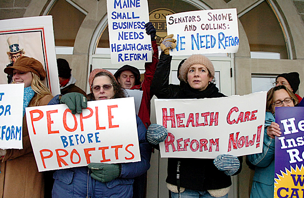 Health reform supporters gather and sing a carol at One Cumberland Place in Bangor on Sunday, Dec. 20, 2009 directed at Maine's senators who were scheduled to vote on the health insurance reform bill. BANGOR DAILY NEWS PHOTO BY BRIDGET BROWN
