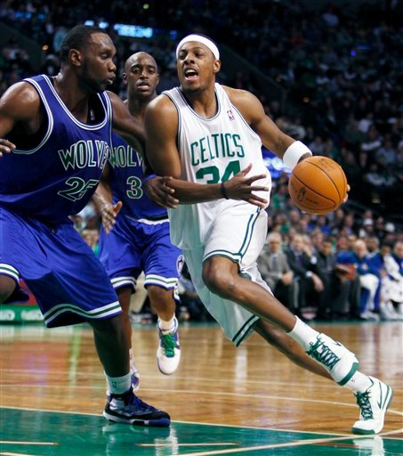 Boston Celtics' Paul Pierce (34) drives for the basket against Minnesota Timberwolves' Al Jefferson, left, in the second quarter of an NBA basketball game, Sunday, Dec. 20, 2009, in Boston. (AP Photo/Michael Dwyer)