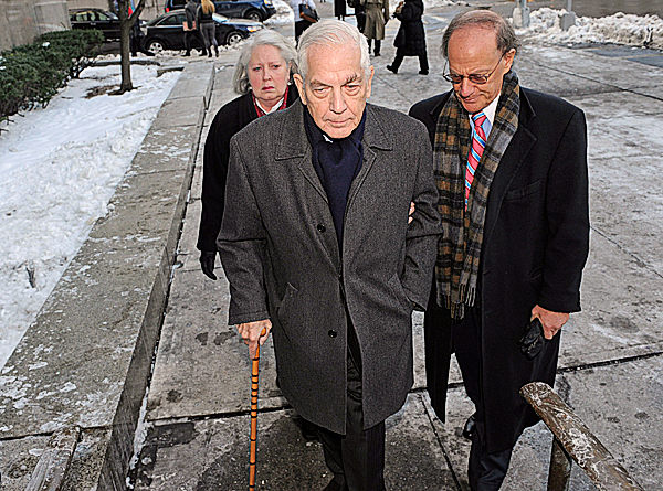 Anthony Marshall, left, the 85-year-old son of philanthropist Brooke Astor arrives at Manhattan State Supreme Court for his sentencing with his wife Charlene, and his  attorney Ken Warner, Monday Dec. 21, 2009, in New York.  Marshall was sentenced Monday to one to three years in prison for exploiting his mother's mental frailty to plunder her millions.   AP PHOTO BY LOUIS LANZANO