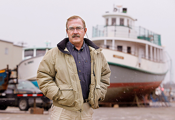 Tom Toye III poses Sunday, Dec. 20, 2009 at a marina in Portland, Maine. Toye is suing the state claiming he shouldn't have to pay a $60,000 &quotuse tax&quot bill for a 72-foot yacht he bought in Florida then brought to Maine. AP PHOTO BY JOEL PAGE