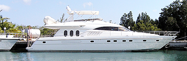 This March 2006 photo provided by Tom Toye III shows his yacht, October Princess, docked in the Bahamas. Toye is challenging a Maine ruling that he owes a usage tax and penalties on the boat that he bought in Florida then brought to Maine.  AP PHOTO BY ROBERT PAINE