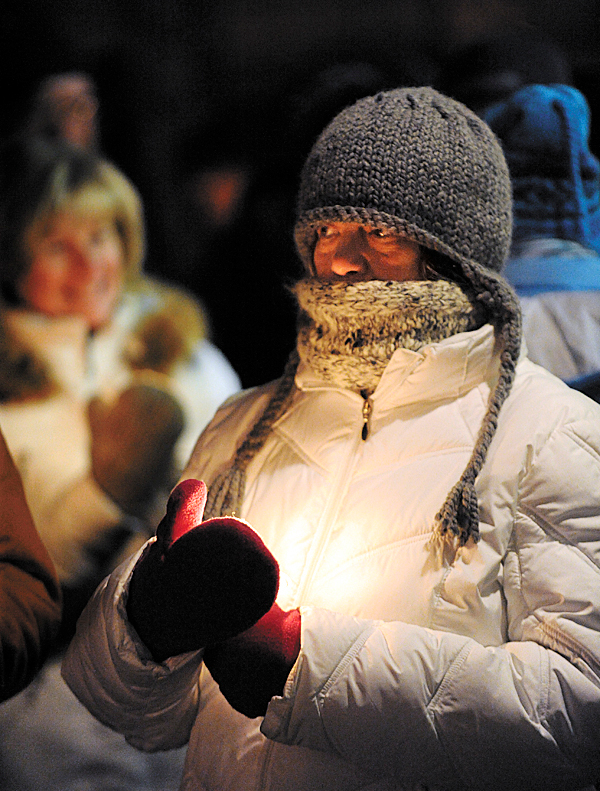 Lisa Asaro, a homeless person who is living at the Greater Bangor Area Homeless Shelter, holds a candle as she waits for the start of the Homeless Person's Memorial Day walk to the Hammond Street Congregational Church on Monday, December 21, 2009. Asaro was joined by approximately 100 people who braved the 21 degree temperature on the longest night of the year to make the 10 minute walk. (Bangor Daily News/Kevin Bennett)