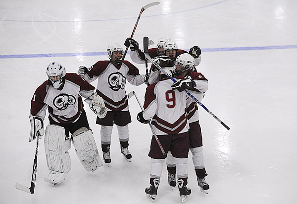 Bangor High's Nick George (#9) is congratulated by teammates after scoring the team's second goal in the second period of their match with Brewer High School at Sawyer Arena in Bangor Tuesday night, December 22,2009. (Bangor Daily News/John Clarke Russ)