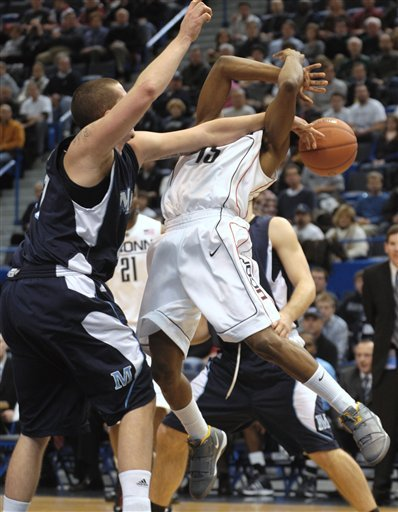Connecticut's Kemba Walker (15) has the ball knocked away by Maine's Sean McNally, left, in the first half of an NCAA college basketball game in Hartford, Conn., Tuesday, Dec. 22, 2009.  (AP Photo/Jessica Hill)