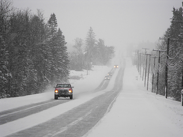 Littleton: It was slow going for travelers in Aroostook County on Wednesday, as a winter storm dumped more than a foot of snow on some towns by 1 p.m. Here, motorists creep along a snow covered section of U.S. Route 1 in Littleton late Wednesday afternoon. The storm was expected to bring 20 inches of snow to some parts of the region before moving out of the area late on Wednesday evening. (BANGOR DAILY NEWS PHOTO BY JEN LYNDS)