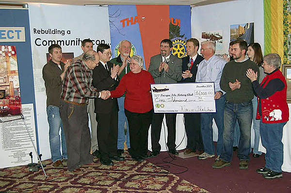 Rotary aids PI club in fundraising for building