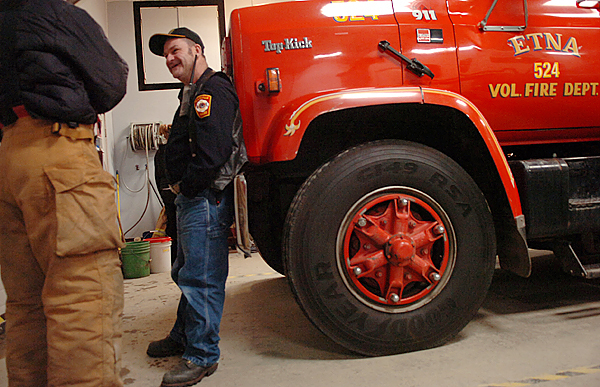 David Ledin talks to Steve DeWitt (left) prior to a training session Wednesday, Dec. 16, 2009 at the Etna Volunteer Fire Department which Ledin has volunteered at for several years. &quotIt makes you appreciate life because the simple things to him mean everything,&quot said DeWitt of working alongside Ledin who faithfully comes to the department's training sessions twice a month. (Bangor Daily News/Bridget Brown)