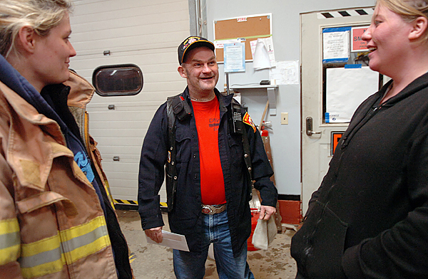 Etna Volunteer Fire department members (from left) Amanda Lane, David Ledin, and Tina Wolfe recount a humorous mishap at a training session Wednesday, Dec. 16, 2009 where Ledin has volunteered for several years. &quotProbably the biggest thing Dave contributes is spirit,&quot said Fire Chief Walter Gibbons of Ledin's involvement with the department. (Bangor Daily News/Bridget Brown)