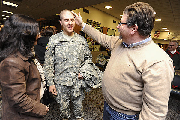 Harold Clossey of Robbinston runs his hand over the freshly shaven head of his son, Private First Class Zane Clossey,19, after the the younger Clossey's civilian flight arrived at Bangor International Airport early Saturday morning, December 19, 2009. On the left is his mom, Trish Hopkins, of St. Stephen, New Brunswick. The young Clossey just finished basic training and heads to Fort Hood after visiting his family on both sides of the border over the holidays. BANGOR DAILY NEWS PHOTO BY JOHN CLARKE RUSS