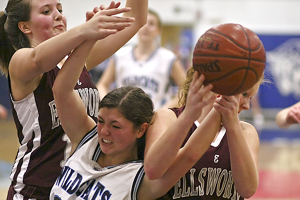 Presque Isle Wildcat Kayla Richards fights for the loose ball under her own basket against Ellsworth Eagle defenders (R)Marrissa Johnson and (L)Sarah Stanley during  the 3rd period of game ,held in Presque Isle. The Wildcats won 57-29. (Dave Allen photo)