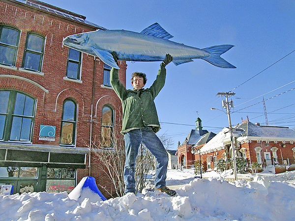 Bill Schaefer of East Machias, Maine lifts the Great  Sardine in front of the Tides Institute in preparation for the New  Year's Eve Great Sardine and Maple Leaf Drop. PHOTO BY HUGH FRENCH