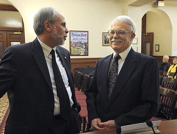 ?Lewiston's acting city administrator Phil Nadeau, left, chats with the new incoming city administrator Ed Barrett prior to the start of the city council meeting on Tuesday, December 1, 2009. (Jose Leiva/Lewiston Sun Journal)