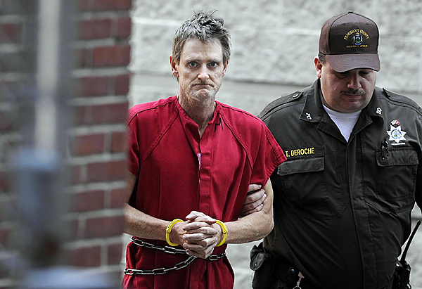 (Perley Goodrich Jr. is escorted from jail to Penobscot Superior Court Friday afternoon, Oct. 30, 2009. Goodrich was arrested in the Newport Big Stop after being spotted there early Friday morning. State and local police spent most of this week on a manhunt for Goodrich who is wanted for questioning following the Monday night murder of his father and severe beating of his mother at their home in Newport. )(AP Photo/Bangor Daily News, John Clarke Russ) **NO SALES, INTERNET OUT, MAGS OUT, MANDATORY CREDIT**