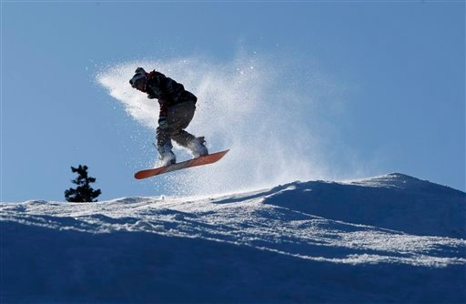 In this Nov. 19, 2009 file photo, Darren Crawford of Old Orchard Beach, Maine, rides his snowboard at the Sunday River ski resort in Newry, Maine. (AP Photo/Robert F. Bukaty,File)