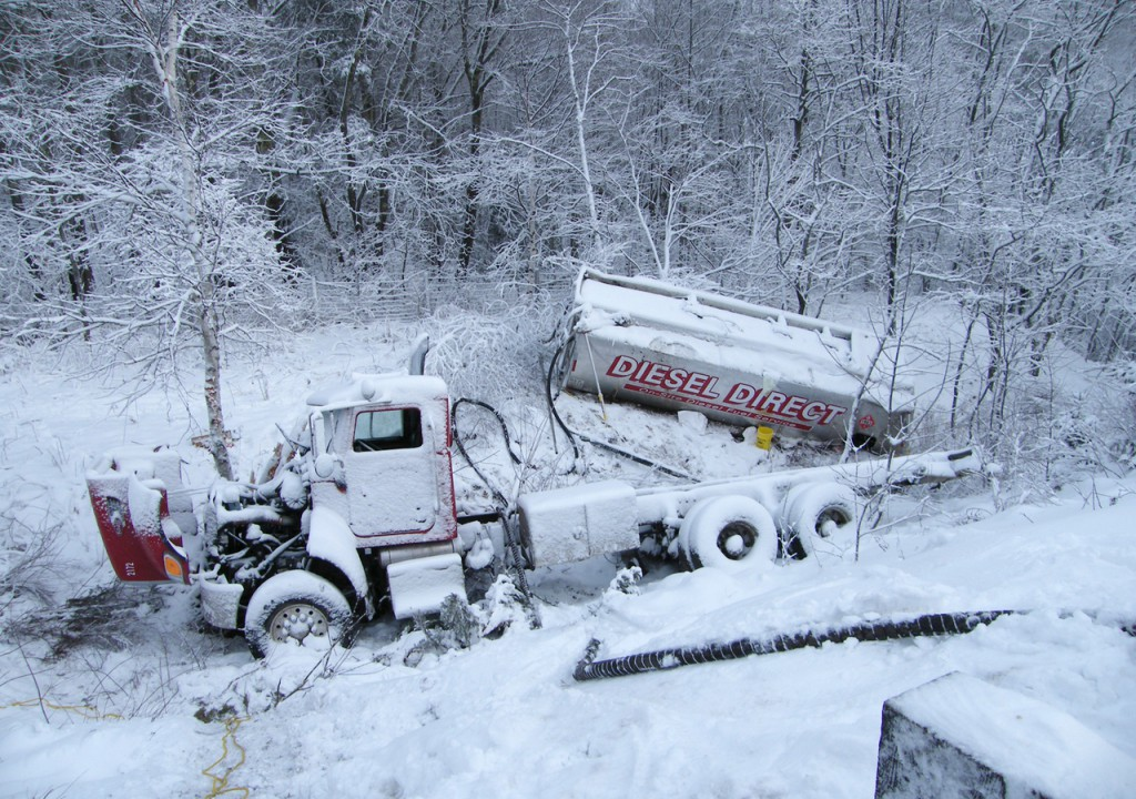 A diesel delivery truck rolled over into a brook off Route 1 in Orland near the Ellsworth town line Tuesday morning.  Orland Fire Dept. personnel responded to a call from State Police that came in from Bucksport Dispatch at about 1:38 am State Police requested OFD response to the scene of the crash. As of 11:21 am, OFD personnel are still at the scene. Bucksport ambulance transported the driver to EMMC. Bucksport FD brought absorbant booms to the scene where OFD used them to help control the spill of fuel into the stream near Patten Pond. Maine DEP, State Police, the trucking company and its clean-up contractors have been at the scene. Some of them are still there and said they may be there for more than one day. (Photo courtesy of Sharon Bray/Orland Fire Dept.)