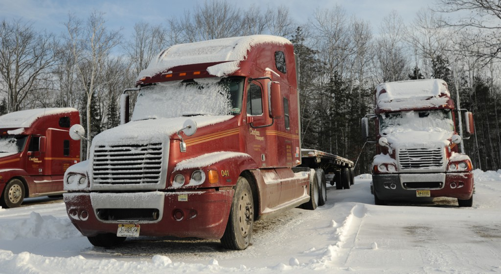 Tractor trailer trucks sit idle behind Carlen Transport's Mecaw Road offices in Hampden on Tuesday, December 29, 2009. Owner Lenny Peters has annonced the closing of Carlen Transport, putting 100 people out of jobs. (Bangor Daily News/Kevin Bennett)