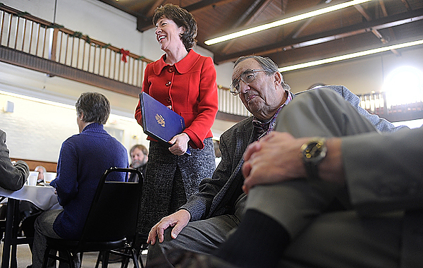 U.S. Senator Susan Collins (R-Maine) approaches the lectern as the featured speaker during Bangor Rotary Club's weekly Tuesday luncheon meeting at Wellman Commons in Bangor December, 29, 2009. BANGOR DAILY NEWS PHOTO BY JOHN CLARKE RUSS