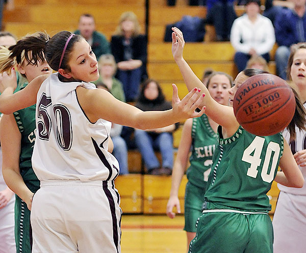 Orono's Jillian Woodward, (50), has the ball go just out of reach on a rebound with Schenck's Jade DiCentes, (40), in the first half of their game at Orono, Monday, Dec. 28, 2009. Bangor Daily News/Michael C. York
