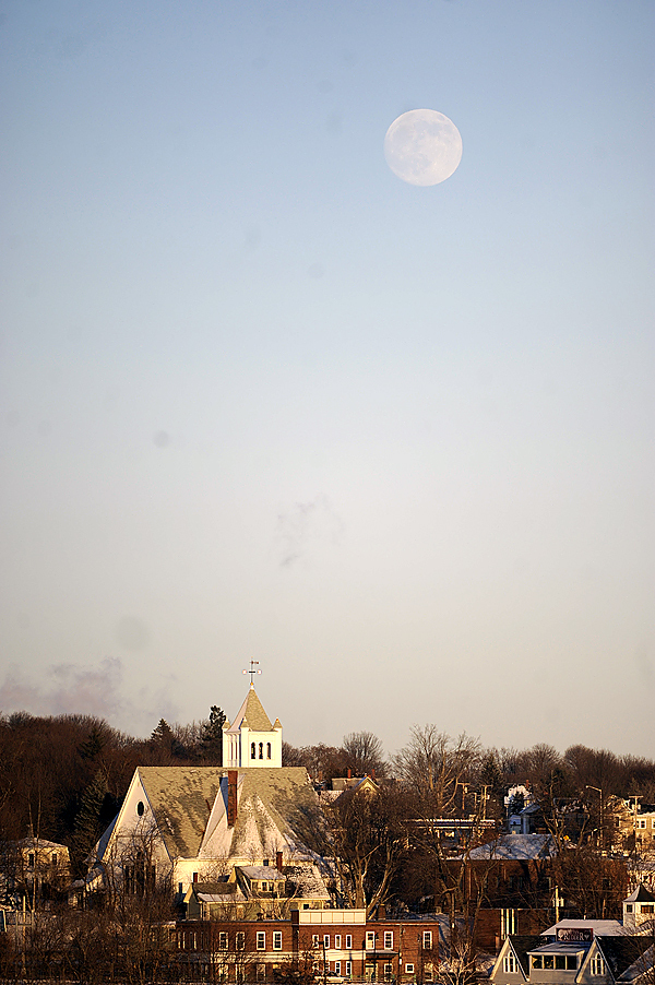 Viewed from the Bangor side of the Penobscot River, a waxing gibbous moon rises over the First Congregational Church of Brewer around 3:30 p.m. Wednesday, December 30, 2009. There will be a blue moon on New Year's Eve. A blue moon occurs when there are two full monns in the same month. The last full moon was December 2. The full moon will occur at 2:13 p.m. and moonrise will occur at 4:00 p.m (in Bangor) on December 31, 2009.(Data from U.S. Naval Observatory). (Bangor Daily News/ John Clarke Russ)