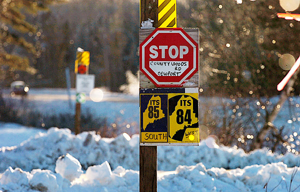 Stop signs indicate a snowmobile trail crossing with the County Woods Road in Newport on Wednesday, Dec. 30, 2009. Both the Governor and the Maine Warden Service joined a couple whose son was killed in a snowmobiling accident earlier this year, to urge sledders to ride safely and check ice thickness before riding on a lake or pond. BANGOR DAILY NEWS PHOTO BY BRIDGET BROWN