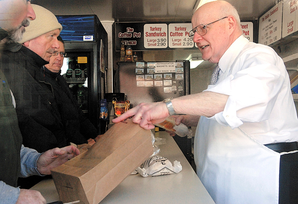 The Coffee Pot owner, Skip Rist ( on right), 72, serves his customers at lunchtime Wednesday, December 30, 2009. Rist announced his family's long-time favorite sandwich shop and landmark with thousands of devoted customers is set to close on New Year's Eve.  BANGOR DAILY NEWS PHOTO BY JOHN CLARKE RUSS
