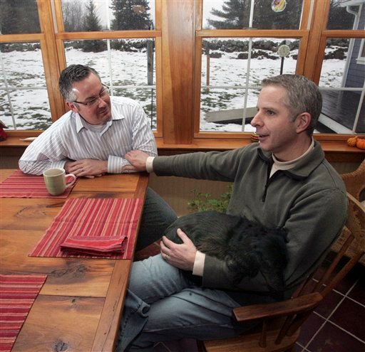 In this photo taken Monday Dec. 28, 2009 Jeffry Burr, left,  and Neil Blair are seen at their home in Franconia, N.H. The gay couple are already civilly committed, but  will finally be legally married Friday, when New Hampshire becomes the fifth state to allow gay couples to wed. (AP Photo/Jim Cole)