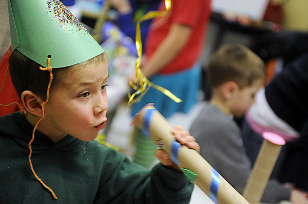 Donning his self-designed New Years party hat,  five-year-old Leo Kasabo-McMahon of Bangor whoops it up during Thursday afternoon's noisemaker and hat making party at Maine Discovery Museum. New Years events took place across the region to usher in 2010. BANGOR DAILY NEWS PHOTO BY JOHN CLARKE RUSS