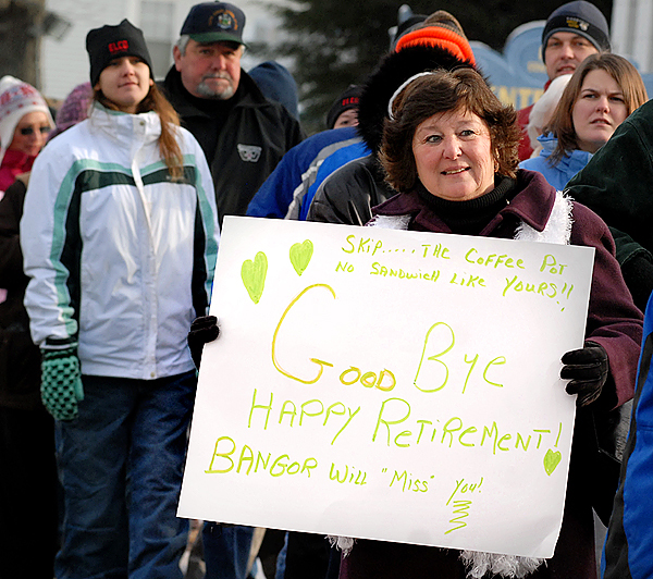 Carole Hoyle of Hampden holds up a sign on Thursday morning while waiting in line along State Street in Bangor for her last Coffee Pot.  &quotNobody makes them as well as he does,&quot said Hoyle of Coffee Pot owner Skip Rist. Thursday was Rist's last day of business before closing the nearly 80-year-old business.  Hundreds of people stood in a line that stretched all the way from the shop on State Stree, down Boyle Street and then along York Street. BANGOR DAILY NEWS PHOTO BY LINDA COAN O'KRESIK