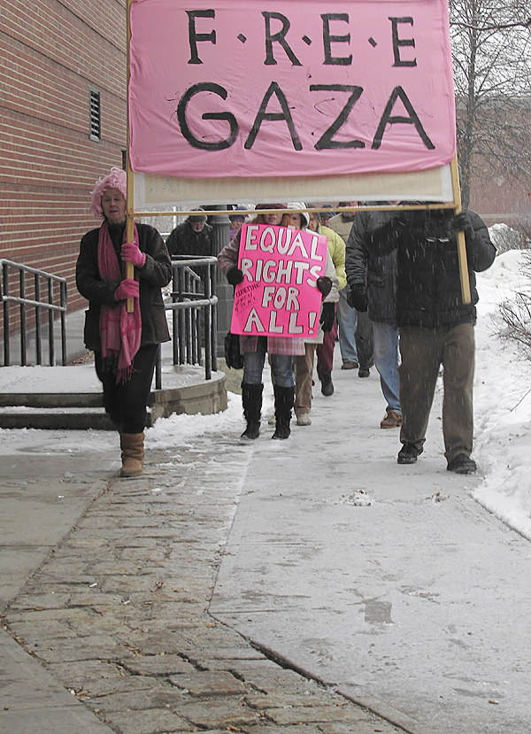 About 25 people who gathered in Waterville's Castonguay Square Thursday to protest the blockade of Gaza by Israel ended their rally with a short march. BANGOR DAILY NEWS PHOTO BY CHRISTOPHER COUSINS