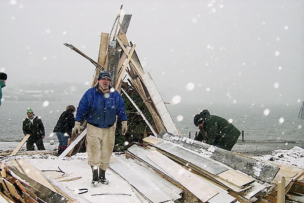Belfast City Councilor Michael Hurley and his team of volunteers were at the city's waterfront Thursday afternoon building the bonfire for last night's 13th Annual New Year's By The Bay celebration. Fuel for the fire was donated by Viking Lumber Co. BANGOR DAILY NEWS PHOTO BY WALTER GRIFFIN