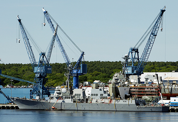 Navy destroyer sails away from Bath Iron Works
