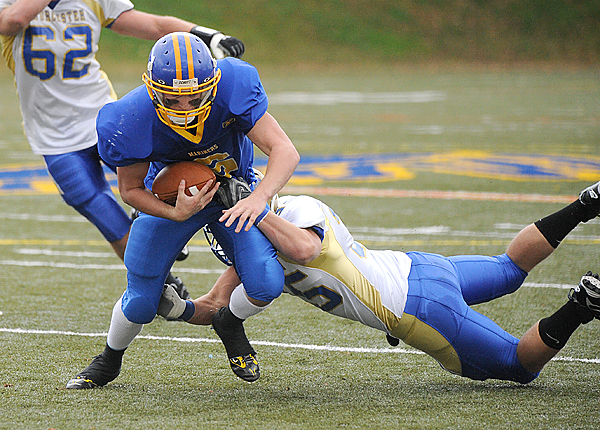 Maine Maritime Academy's Matthew Rende scrambles for more yardage as Worcester State's Tyler Russell dives to tackle him during the second quarter Saturday in Castine. MMA rolled to a 41-20 victory.  (BANGOR DAILY NEWS PHOTO BY GABOR DEGRE)  CAPTION  Maine Maritime Academy's Matthew Rende (left)scrambles for more yardage Worcester's Tyler Russell dives to tackle him during the second quarter of the game in Cactine Saturday afternoon. (Bangor Daily News/Gabor Degre)