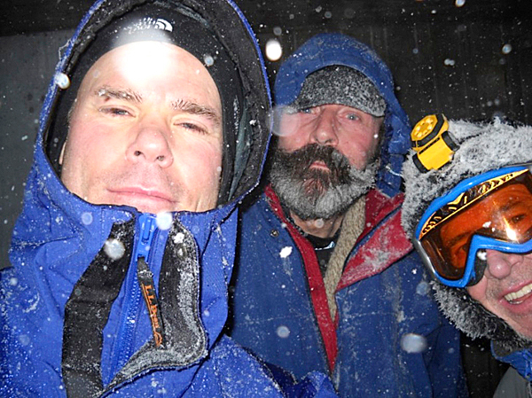 Left to right, Scott Fisher, Don Littlefield and Brad Viles celebrate New Year's with a snowy pre-dawn hike to the top of Cadillac Mountain in Acadia National Park. Climbing the mountain before dawn is a tradition that Viles has observed since New Year's Day, 2000.  BRAD VILES PHOTO