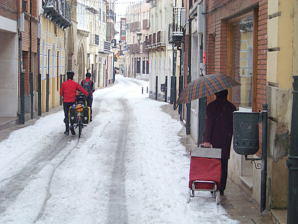 Stopped In Their Tracks: The cyclists push their bikes through a snow covered road in northern Spain. Intense snow storms in Spain are very rare, and local towns do not have the infrastructure, like snow plows, to clean up the roads during freak winter storms. Continuing in these conditions without a more rugged bicycle and better tires is not an option. LEVI BRIDGES PHOTO