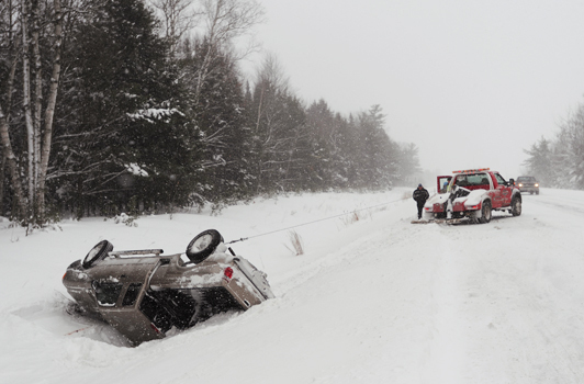 A wrecker pulls a pick-up truck from the ditch of the north bound lane of interstate 95 in Bangor near the Hogan Road exit, after it rolled over on Saturday, January 2, 2009.  BANGOR DAILY NEWS PHOTO BY KEVIN BENNETT