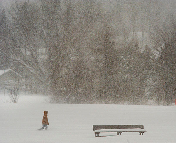 A young adventurer sets off across the snowy soccer pitch in Old Town, Saturday, Jan. 2, 2010.  BANGOR DAILY NEWS PHOTO BY MICHAEL C. YORK