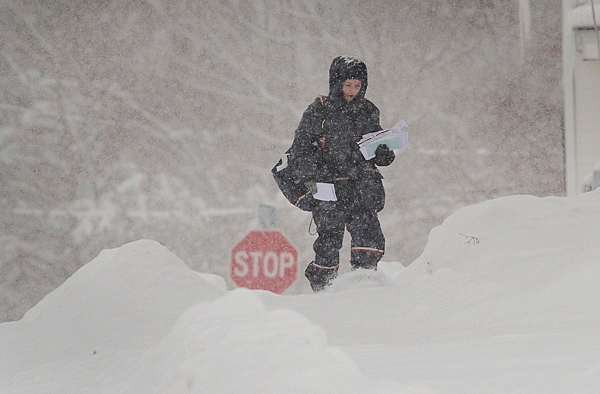 One of Old Town's US Postal Dept. employees trudges through the snow Saturday on her rounds, Jan. 2, 2010.  BANGOR DAILY NEWS PHOTO BY MICHAEL C. YORK