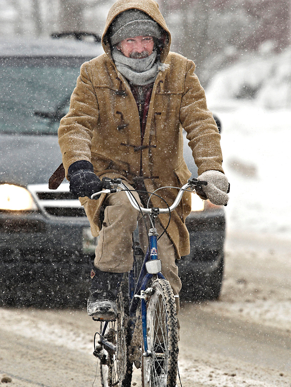 ...and then there are those that just live with what happens such as this seasoned cyclist in Old Town, Saturday, Jan. 2, 2010. BANGOR DAILY NEWS PHOTO BY MICHAEL C. YORK